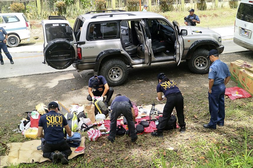 Police investigators collect evidence at a crime scene following an operation in the town of Makilala, North Cotabato Province, southern Philippines on Oct 28, 2016.