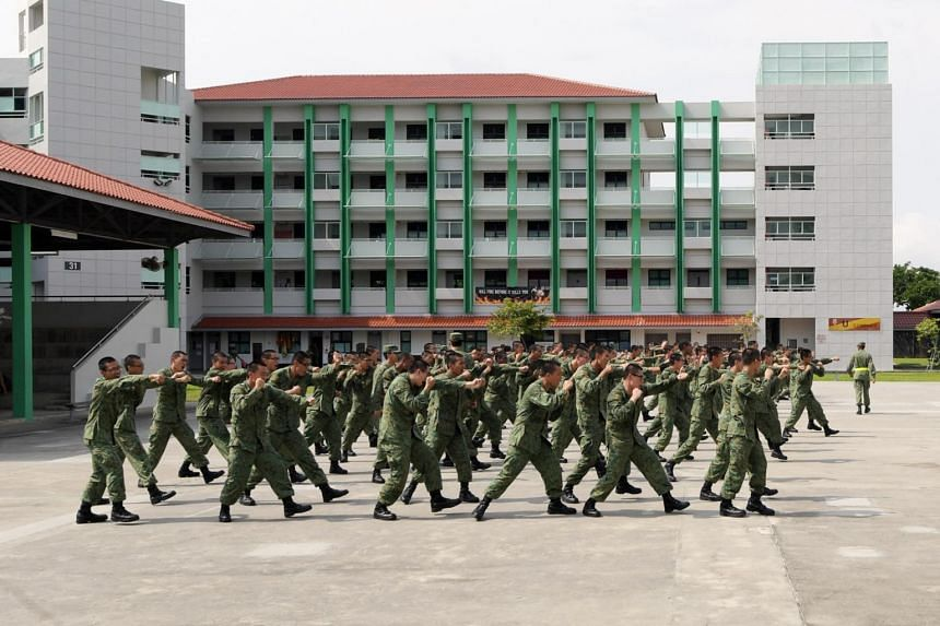 Recruits training in a square at the Basic Military Training Centre on Pulau Tekong.