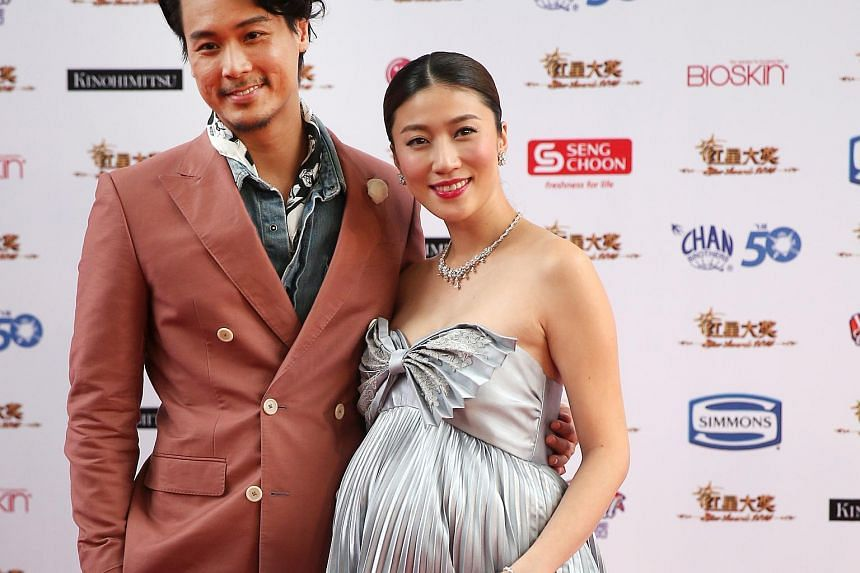 A heavily pregnant Kate Pang with husband Andie Chen on the red carpet of the Star Awards on April 17.