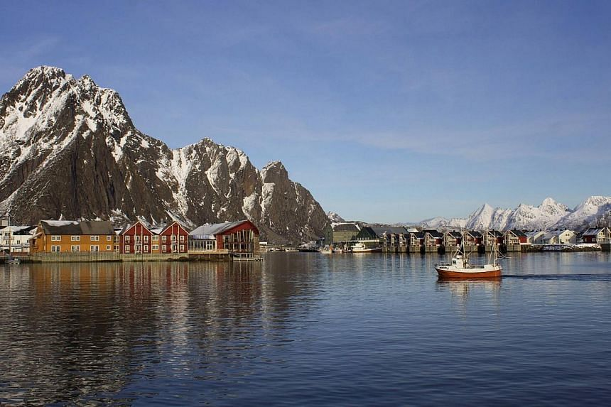 A fishing boat enters the harbour at the Arctic port of Svolvaer in northern Norway on March 4, 2013. Singapore, China and four other countries were granted observer status at the 8th Ministerial Meeting of the Arctic Council held in Kiruna, Sweden,