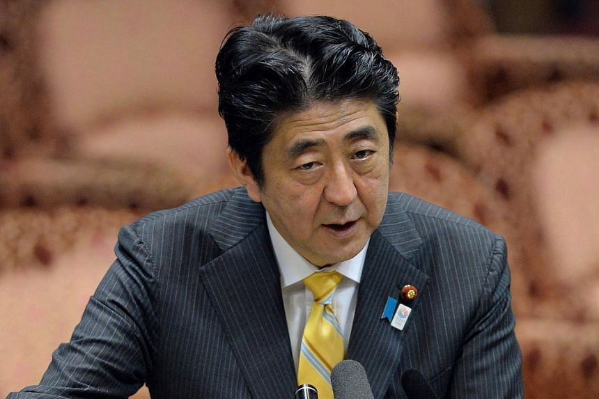 Japanese Prime Minister Shinzo Abe answers a question at the Upper House's budget committee session at the National Diet in Tokyo, on May 15, 2013. Mr Abe said on Wednesday he may consider meeting North Korean leader Kim Jong Un if it would help reso