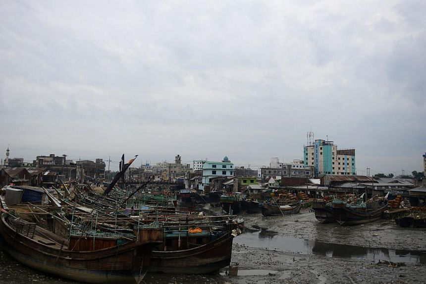 Fishing boats are tied up in the harbour of Chittagong on Wednesday, May 15, 2013 during preparations for the expected arrival of Cyclone Mahasen. Bangladesh on Wednesday ordered the evacuation of hundreds of thousands of people as forecasters said a
