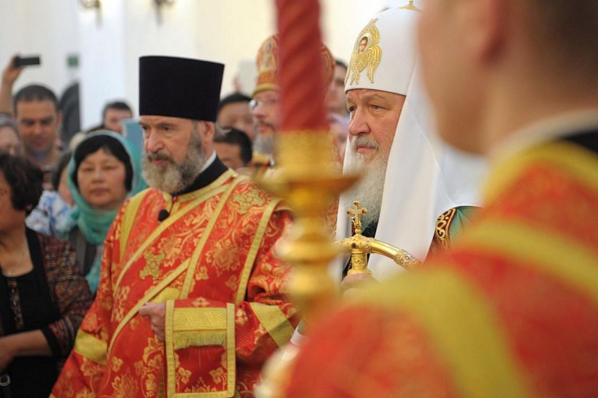 The head of the Russian Orthodox Church, Patriarch Kirill (second from right), takes part in a service in the historic Russian Orthodox church in Shanghai, on Wednesday, Wednesday, May 15, 2013. The head of the Russian Orthodox Church held a service