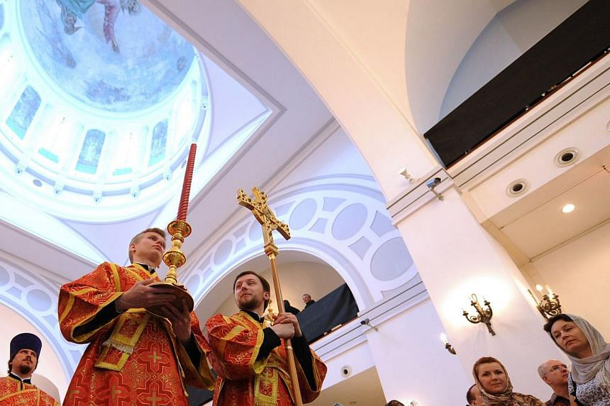 Clergy wait for the arrival of the head of the Russian Orthodox Church, Patriarch Kirill, in the historic Russian Orthodox church in Shanghai for a service, on Wednesday, May 15, 2013. The head of the Russian Orthodox Church held a service in a histo