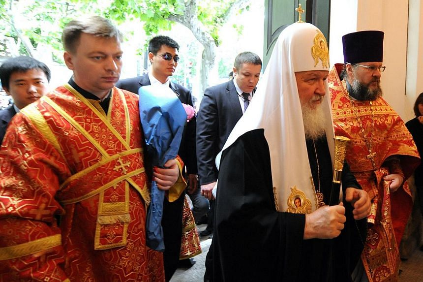 The head of the Russian Orthodox Church, Patriarch Kirill (right), arrives at the historic Russian Orthodox church in Shanghai for a service, on Wednesday, May 15, 2013. The head of the Russian Orthodox Church held a service in a historic Shanghai ch