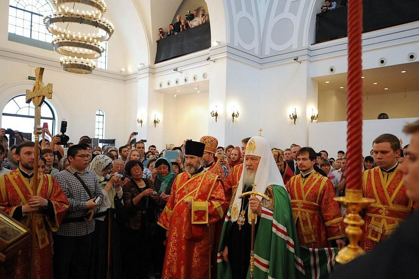 The head of the Russian Orthodox Church Patriarch Kirill (centre right), arrives at the historic Russian Orthodox church in Shanghai on Wednesday, May 15, 2013. The head of the Russian Orthodox Church held a service in a historic Shanghai church on W