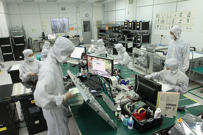 Staff members at work at R-Logic, an SME offering repairs and customer care services for consumer electronics. Small and medium-sized enterprises in Singapore will be able to tap on a new $17 million government scheme to boost energy efficiency. -- S
