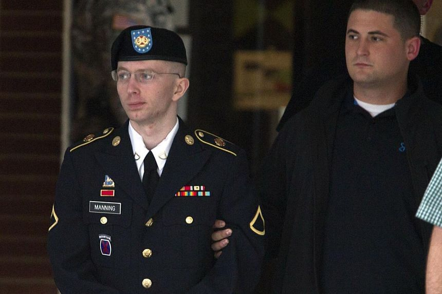 Army Pfc. Bradley Manning is escorted out of a courthouse in Fort Meade, Md., Monday, July 8, 2013, after the start of the sixth week of his court martial. Defence lawyers for army private Bradley Manning, who has admitted to handing WikiLeaks a