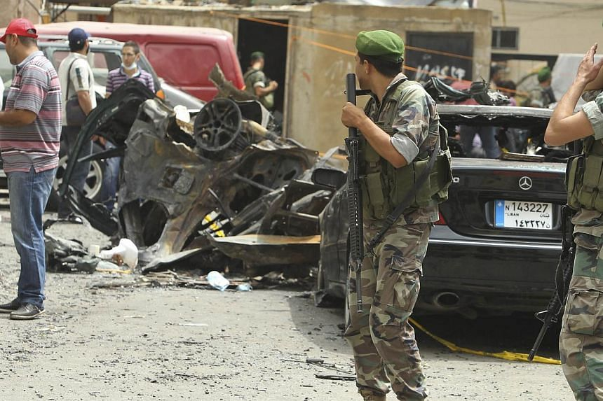 Lebanese army soldiers secure the site of an explosion in Beirut's southern suburbs, on July 9, 2013. A car bomb exploded on Tuesday in a Beirut stronghold district of the Lebanese Hezbollah militant group that has been fighting in Syria's civil war,