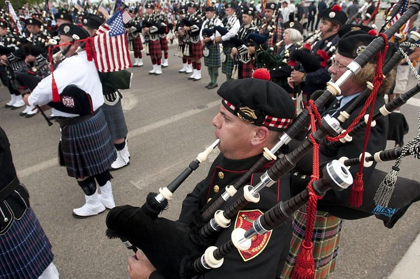 Bagpipers play at the end of the memorial service outside Tim's Toyota Center in Prescott Valley, Arizona, on July 9, 2013.Thousands of mourners, including United States (US) Vice-President Joe Biden, paid tribute on Tuesday to 19 Arizona firemen kil