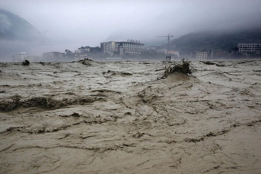 Heavy flood waters sweeping through Beichuan in southwest China's Sichuan province on July 9, 2013. Between 30 and 40 people were buried by a landslide in China on Wednesday, July 10, 2013, the state news agency Xinhua reported, citing local off