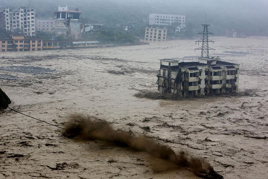 Heavy flood waters sweeping through Beichuan in southwest China's Sichuan province on July 9, 2013.Between 30 and 40 people were buried by a landslide in China on Wednesday, July 10, 2013, the state news agency Xinhua reported, citing local off