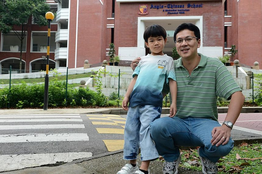 Dr Adrian Loh and his son, Joash, at ACS (Primary), where the boy is registered for Primary 1 next year. Dr Loh said he joined the school's Old Boys' Association three years ago but is not an active member.