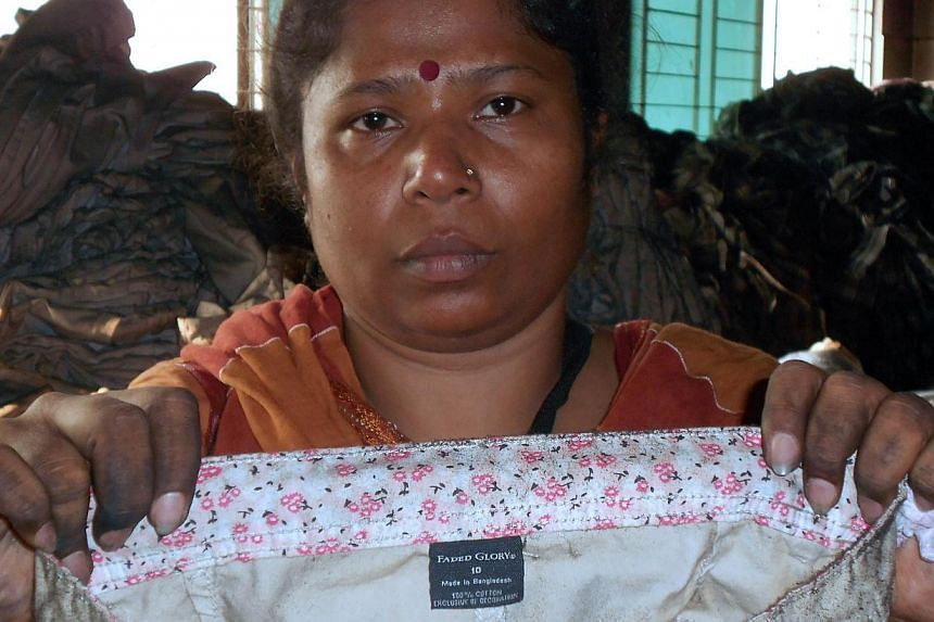 In this handout photograph released by The Bangladesh Garment and Industrial Workers Federation (BGIWF) and The Bangladesh Center for Workers Solidarity (BCWS) on Nov 27, 2012, shows The Director of BCWS Kalpona Akter (above) as she poses with a garm
