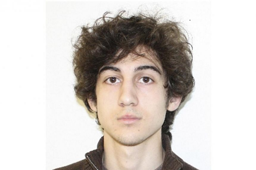 Dzhokhar Tsarnaev (above), the shaggy-haired US university student charged with detonating bombs that killed three people at the Boston Marathon makes his first court appearance on Wednesday, July 10, 2013. -- FILE PHOTO: REUTERS