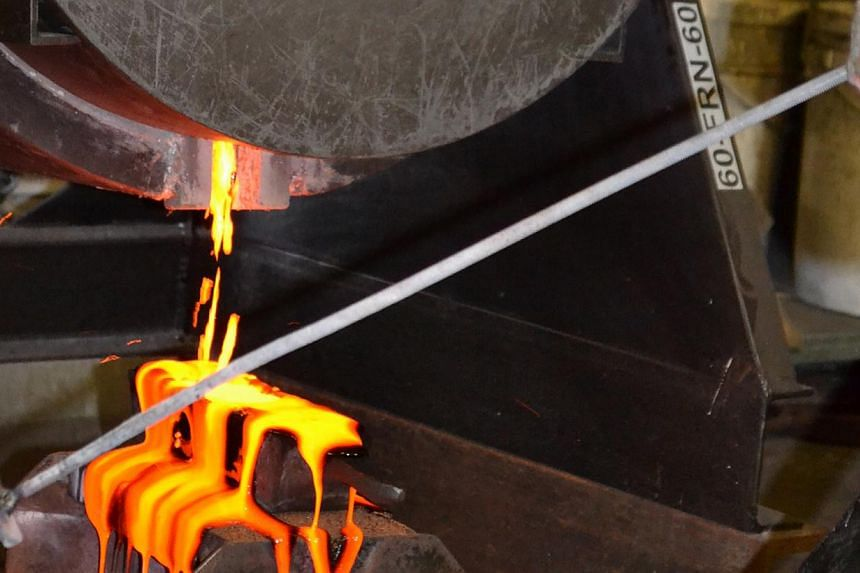 Tiny pieces of gold from the rock and gravel in the mine are smelted into gold bars. Singapore's first mainboard-listed gold company, LionGold Corp, said it has raised its annual gold production target from 120,000 ounces to 200,000 ounces. -- FILE P