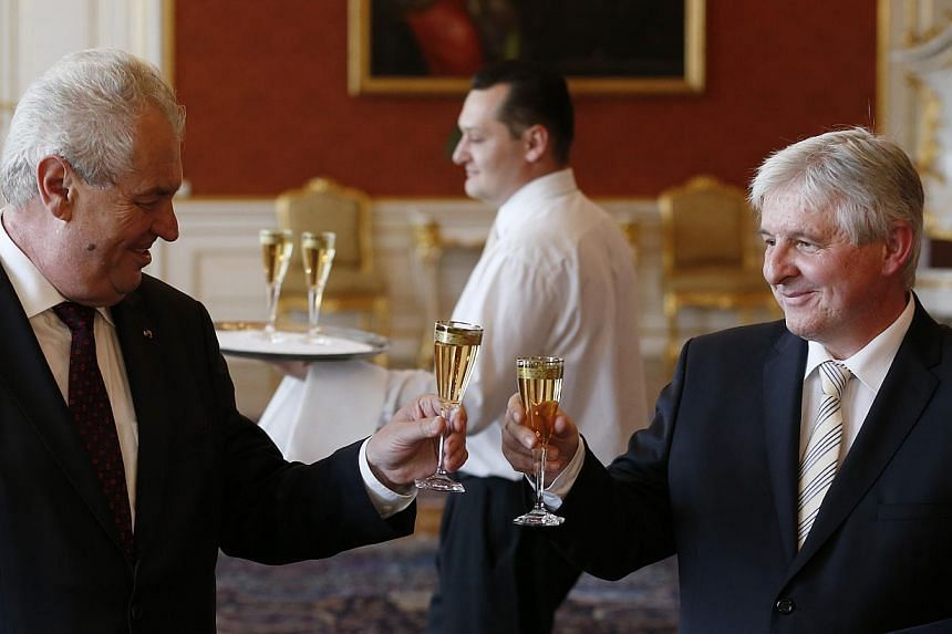 New Czech Prime Minister Jiri Rusnok (right) toasts with Czech Republic's President Milos Zeman, at the Prague Castle in Prague, Czech Republic on June 25, 2013. Mr Rusnok said on Wednesday, July 10, 2013, he would negotiate with political parties to