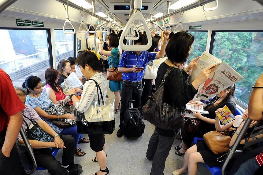 Commuters in a train departing from Pasir Ris MRT Station. Commuters travelling to and from Pasir Ris MRT station on Wednesday morning may have experienced an increased travelling time by about eight minutes.-- TNP FILE PHOTO: JEREMY LONG