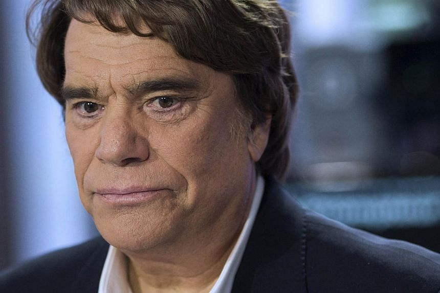 Corruption investigators in France have seized the assets of French tycoon Bernard Tapie (above), suspected of having committed fraud as part of an organised gang, judicial sources said on Wednesday, July 10, 2013. -- FILE  PHOTO: REUTERS