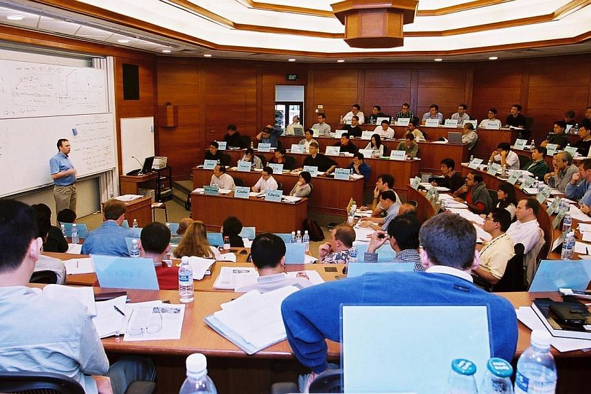 Participants of The University Of Chicago Booth School Of Business Executive MBA programme listening to a lecture. The University of Chicago Booth School of Business will relocate its Asia Executive MBA programme from Singapore to Hong Kong in 2014.