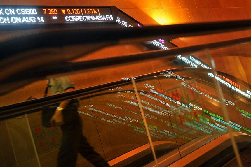 Stock tickers along the wall at the Singapore Exchange Centre 1 building. Singapore shares were soaring mid-session on Thursday on hopes that the United States central bank would continue its massive money-printing programme and keep the global equit
