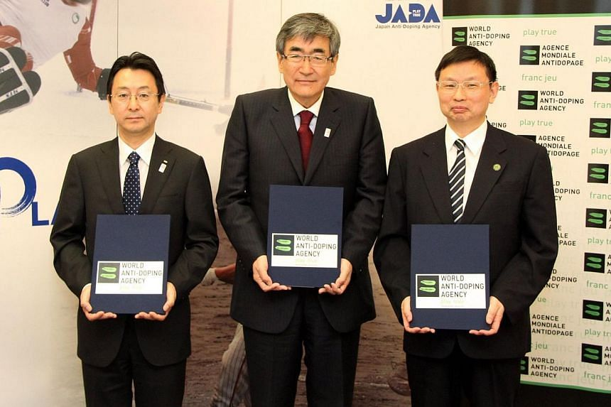 This handout picture taken on June 26, 2013 shows (left to right) President of Japan Anti-Dopiong Agency (JADA) Hidenori Suzuki, President of Federation of Pharmaceutical Manufacture's Association (FPMAJ) Haruo Naito and Director of World Anti-Doping