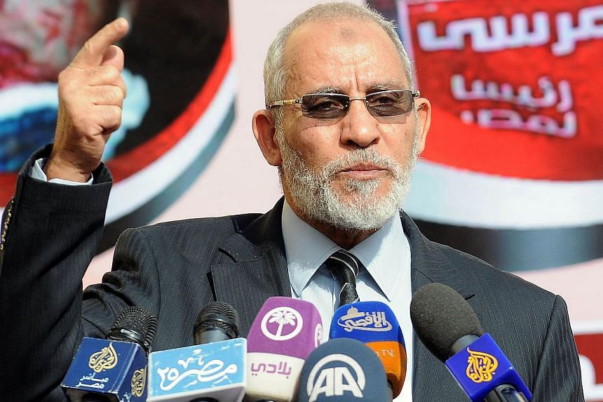 A Dec 8, 2012 file photo shows Muslim Brotherhood leader Mohammed Badie speaking during a press conference at the party's headquarters in Cairo. Egypt's new leadership faced increased difficulties on Thursday in forming an interim government after it