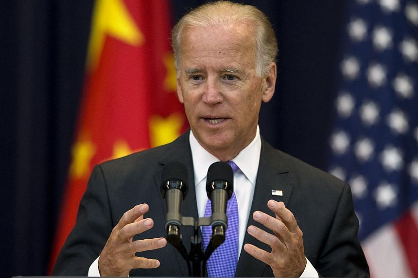 """Vice President Joe Biden gestures while speaking at the opening session of the 2013 Strategic and Economic Dialogue, Wednesday, July 10, 2013, at the State Department in Washington. Mr Biden urged China on Wednesday to end its """"outright"""" theft throug"""