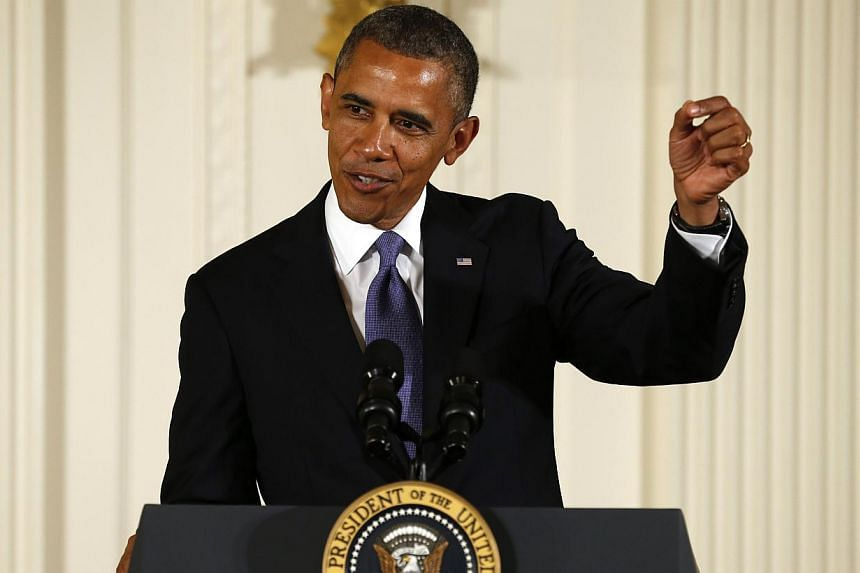US President Barack Obama makes a light reference to old movie special effects while speaking about award recipient George Lucas who created Star Wars during the National Medal of Arts and National Humanities Medal ceremony at the White House in Wash