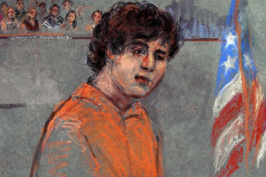 "This courtroom sketch depicts Boston Marathon bombing suspect Dzhokhar Tsarnaev during arraignment in federal court on July 10, 2013 in Boston. Wearing an orange prison jumpsuit, with his arm in a cast, Tsarnaev pleaded ""not guilty"" to committin"