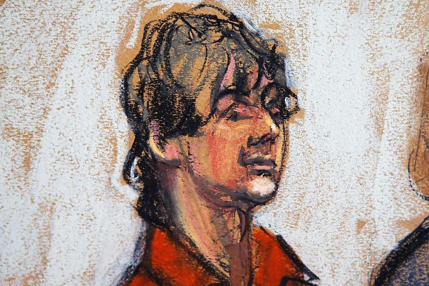 """Dzhokhar Tsarnaev appears in court in Boston, Massachusetts, in this July 10, 2013, court sketch.Wearing an orange prison jumpsuit, with his arm in a cast, Tsarnaev pleaded """"not guilty"""" to committing the worst mass-casualty attack on United Sta"""