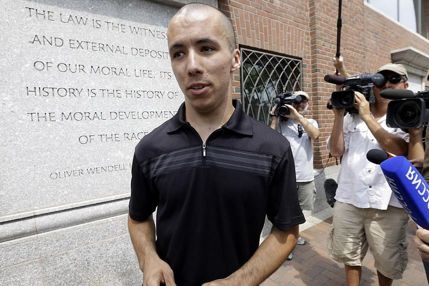 Marathon runner Robert Wheeler speaks with reporters outside the federal courthouse prior to the arraignment for Boston Marathon bombing suspect Dzhokhar Tsarnaev on July 10, 2013, in Boston. Wearing an orange prison jumpsuit, with his arm in a cast,