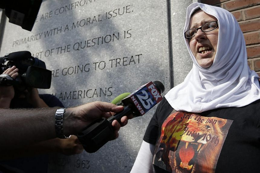 Ms Mary Churbuck (right), of Freetown, Massachusetts, a supporter of Boston Marathon bombing suspect Dzhokhar Tsarnaev, speaks with members of the media outside the federal courthouse following the arraignment for Tsarnaev on July 10, 2013, in Boston