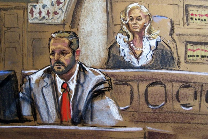 Judge Marianne Bowler (right) looks on along with Courtroom Deputy Brendan Garvin as Dzhokhar Tsarnaev appears in court in Boston, Massachusetts, in this July 10, 2013, court sketch. Wearing an orange prison jumpsuit, with his arm in a cast, Tsa