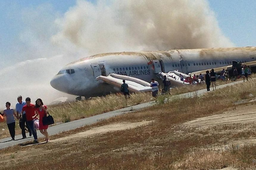 Passengers evacuate the Asiana Airlines Boeing 777 aircraft after a crash landing at San Francisco International Airport in California July 6, 2013 in this handout photo provided by passenger Eugene Anthony Rah released to Reuters on July 8, 2013. Th