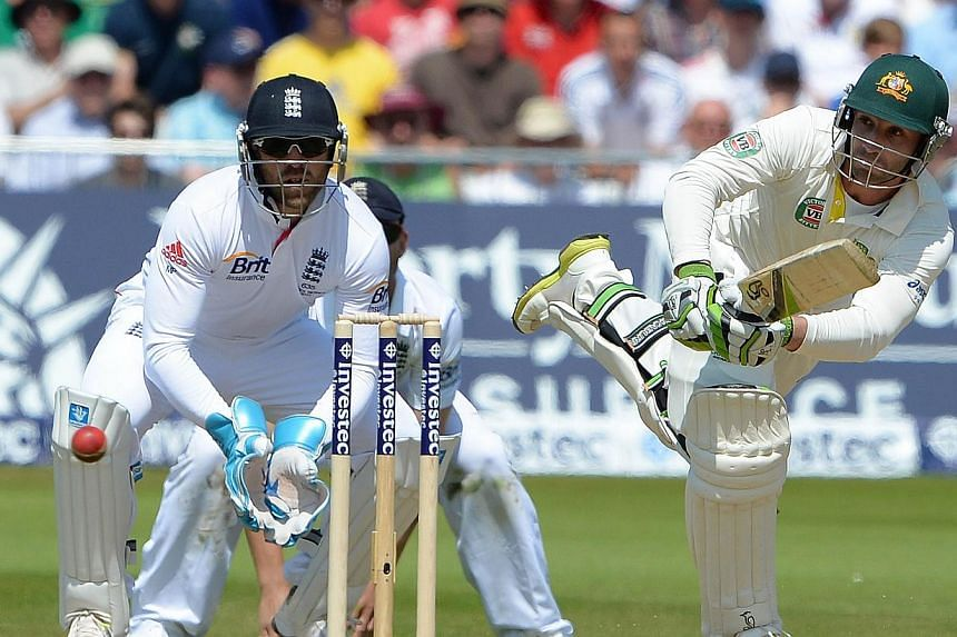 Australia's Philip Hughes (right) plays a shot as England wicketkeeper Matt Prior looks on during the second days play of the first cricket Test match of the 2013 Ashes series between England and Australia at Trent Bridge in Nottingham on Thursday, J