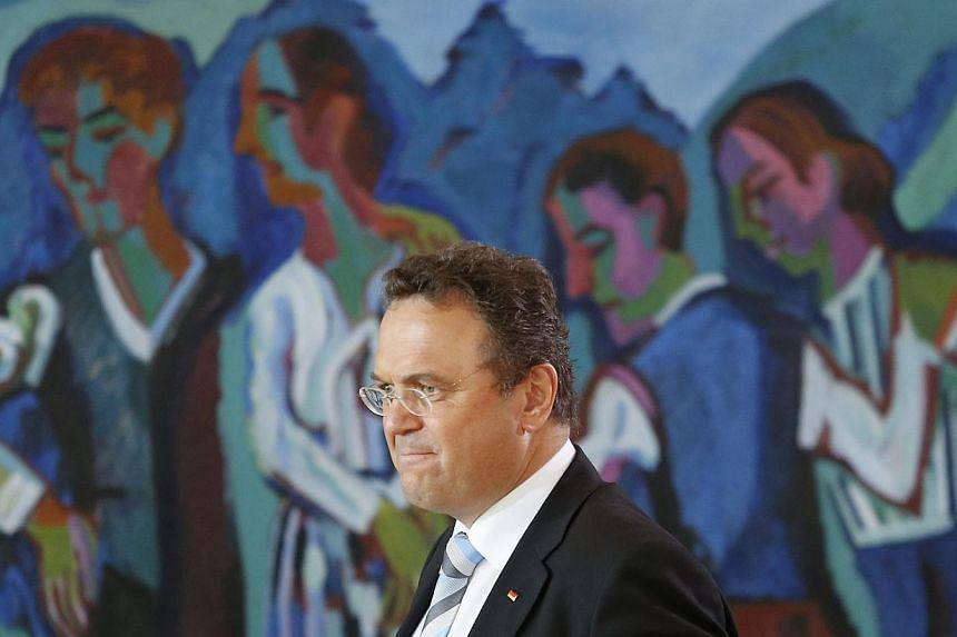 """German Interior Minister Hans-Peter Friedrich arrives for the weekly cabinet meeting at the Chancellery in Berlin on July 3, 2013. Friedrich said he expected """"straight talk"""" at high-level meetings in Washington Thursday, July 11, 2013, on a simmering"""