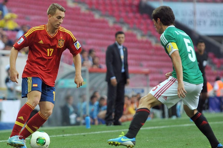 Spain's forward Gerard Deulofeu (left) vies with Mexico's defender Bernando Hernandez during a round 16 stage football match between Spain and Mexico at the Fifa Under 20 World Cup at TT Arena Stadium in Istanbul on July 2, 2013. Everton manager Robe