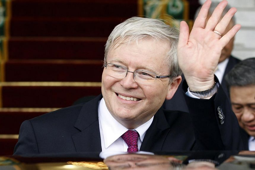 Australian Prime Minister Kevin Rudd waves to the media after a meeting with Indonesia President Susilo Bambang Yudhoyono at Presidential Palace in Bogor, West Java, Indonesia, on Friday, July 5, 2013. Mr Rudd on Thursday said the China resources boo
