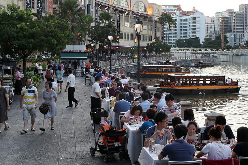 """The new rules issued by URA take effect immediately, but it said it would give operators """"sufficient time"""" to clear the riverside tables such as these at Clarke Quay. Tables away from the river will be allowed to stay."""