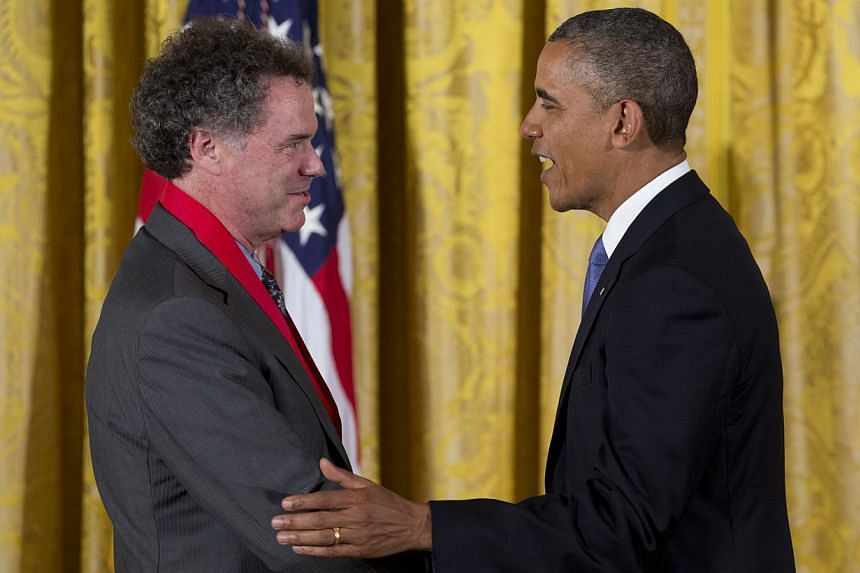 President Barack Obama awards Edward L. Ayers the 2012 National Humanities Medal, for his commitment to making our history as widely available and accessible as possible, during a ceremony in the East Room of White House, Wednesday, July 10, 2013, in