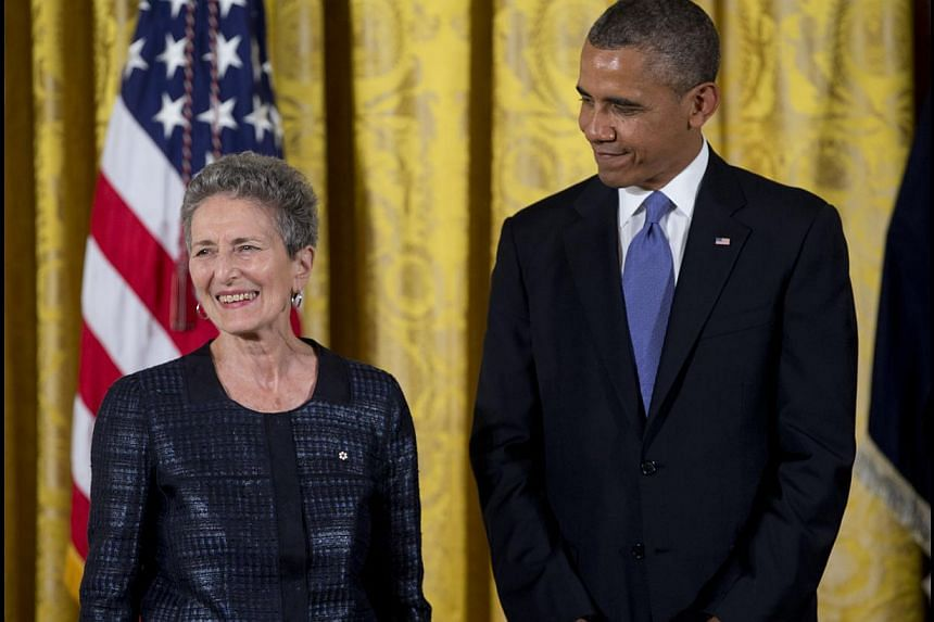 President Barack Obama stands with Natalie Zemon Davis as he awards her the 2012 National Humanities Medal for her insights into the study of history and her exacting eloquence in bringing the past into focus, during a ceremony in the East Room of Wh