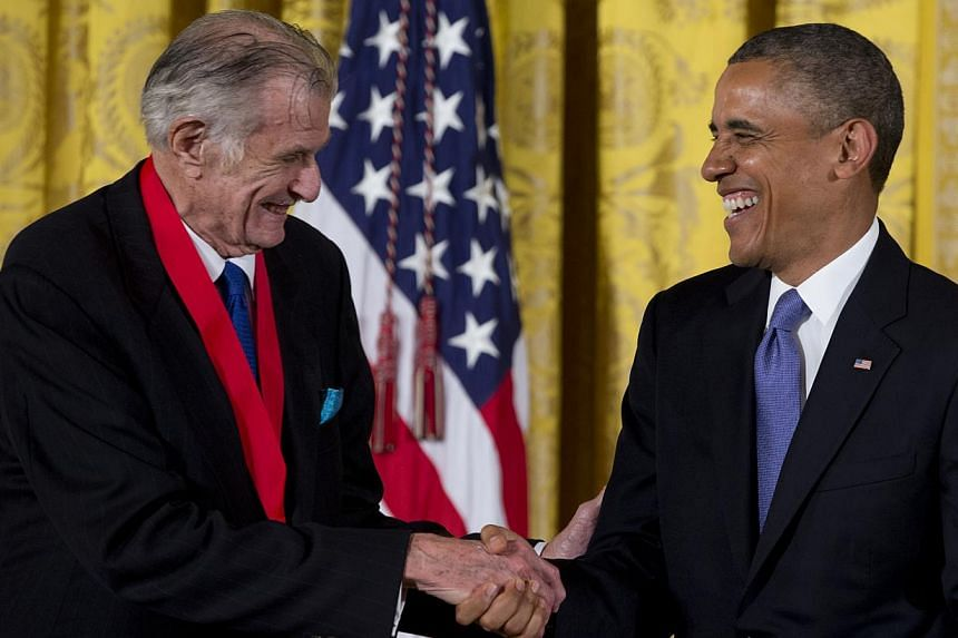President Barack Obama laughs with Frank Deford as he awards him the 2012 National Humanities Medal for transforming how we think about sports, during a ceremony in the East Room of White House, Wednesday, July 10, 2013, in Washington. -- PHOTO: AP