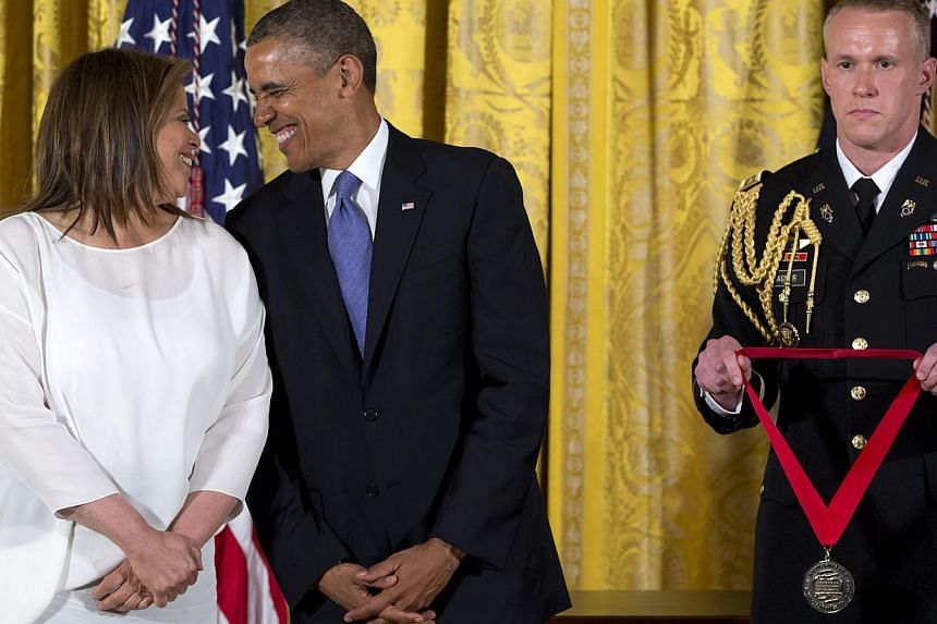 President Barack Obama stands with Anna Deavere Smith as he awards her the 2012 National Humanities Medal for her portrayal of authentic American voices, during a ceremony in the East Room of White House, Wednesday, July 10, 2013, in Washington. -- P