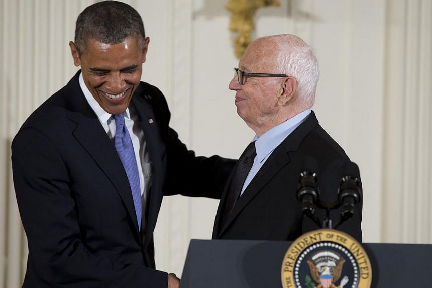 President Barack Obama welcomes Ellsworth Kelly to the stage to award him the 2012 National Medal of Arts for his contributions as a painter, sculptor, and printmaker, Wednesday, July 10, 2013, during a ceremony in the East Room of White House in Was