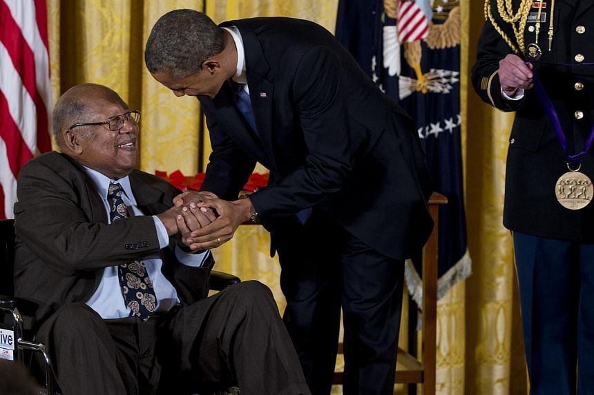 President Barack Obama awards Ernest Gaines the 2012 National Medal of Arts for his contributions as an author and teacher, Wednesday, July 10, 2013, during a ceremony in the East Room of White House in Washington. -- PHOTO: AP