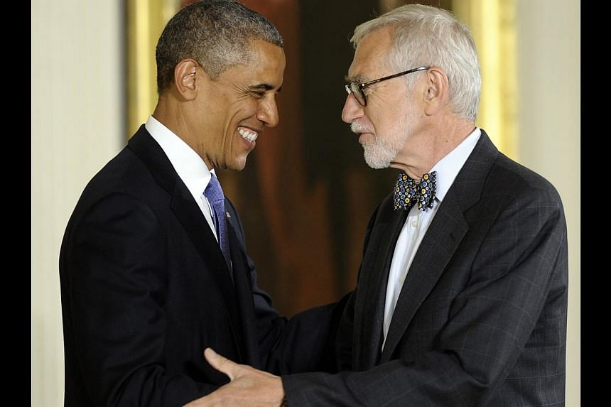 President Barack Obama awards the 2012 National Medal of Arts to Laurie Olin for his contributions as a preeminent landscape architect during a ceremony in the East Room of White House in Washington, Wednesday, July 10, 2013. -- PHOTO: AP