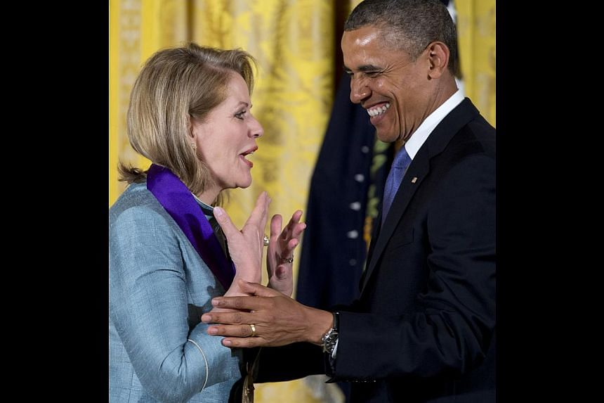 President Barack Obama awards Renée Fleming the 2012 National Medal of Arts for her contributions to American music during a ceremony in the East Room of White House in Washington, Wednesday, July 10, 2013. -- PHOTO: AP