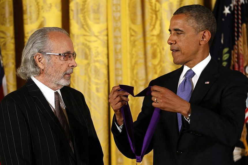 U.S. President Barack Obama awards the 2012 National Medal of Arts to musician Herb Alpert during a ceremony in the East Room of the White House in Washington on July 10, 2013. -- PHOTO: REUTERS