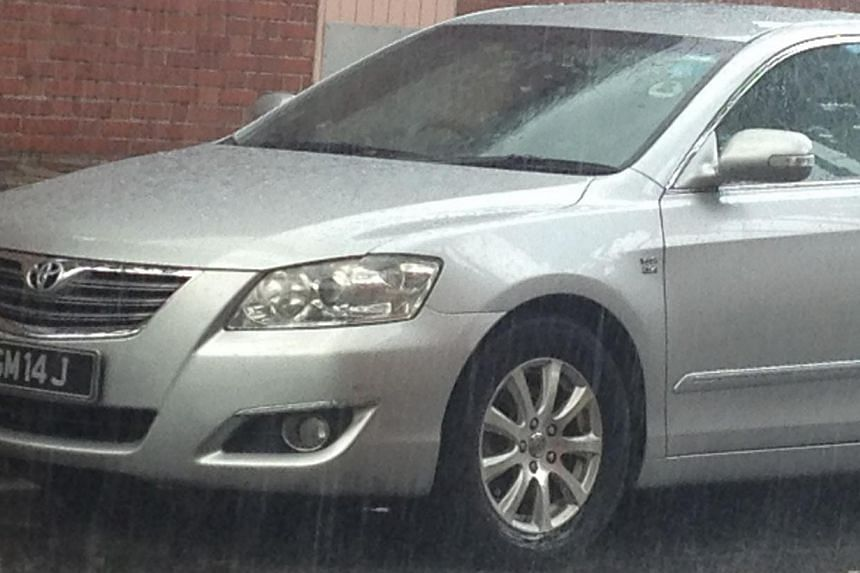 Police have located the silver Toyota Camry with the licence plate SGM 14J, which was involved in the suspected double murder of a father and son in Kovan on Wednesday. The car was found along Block 1084, Eunos Avenue 7. -- ST PHOTO: JALELAH ABU BAKE